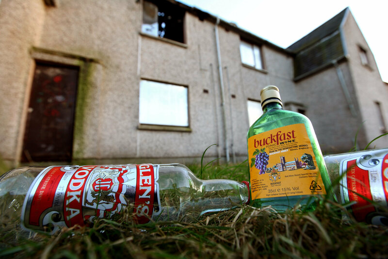 Empty bottles of Vodka and Buckfast, lay outside a disused house in Kirkcaldy, Scotland.