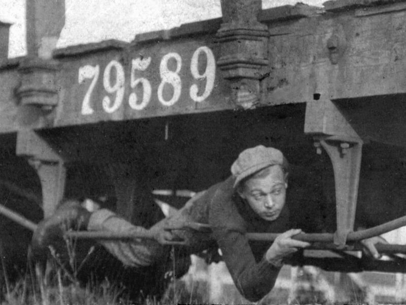 A hobo riding the rails, 1930s.
