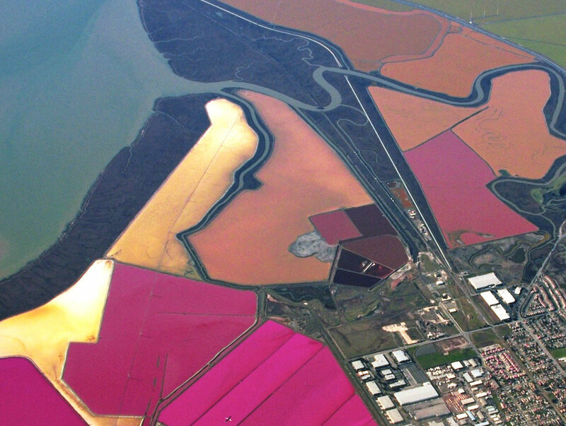 The brightly colored salt ponds seen from above.