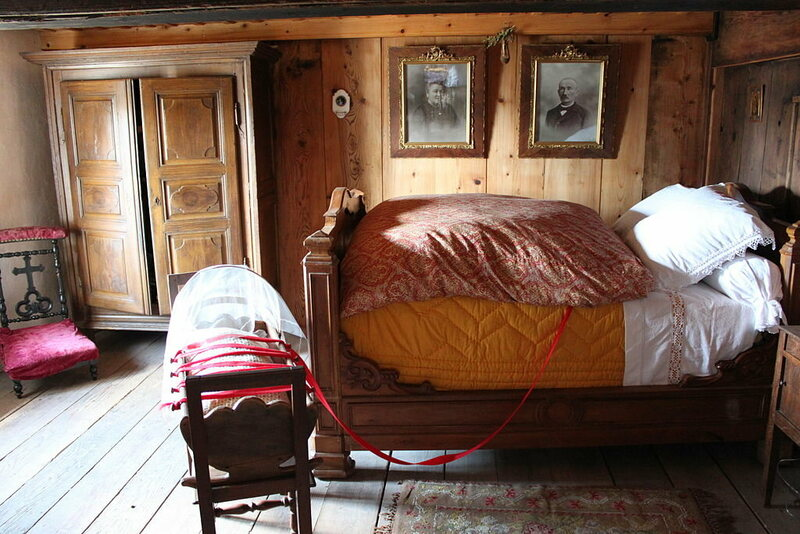 A bed with a bassinet.