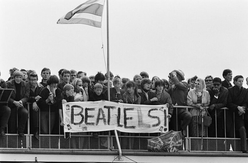 Young fans await their idols at Amsterdam Airport Schiphol.