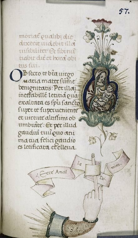 "An elaborate manicule that forms part of the illustration, pointing towards the Virgin Mary and Jesus. The Latin words <em>Ecce Ancilla Domini</em> translate to ""Behold the handmaid of the Lord."""