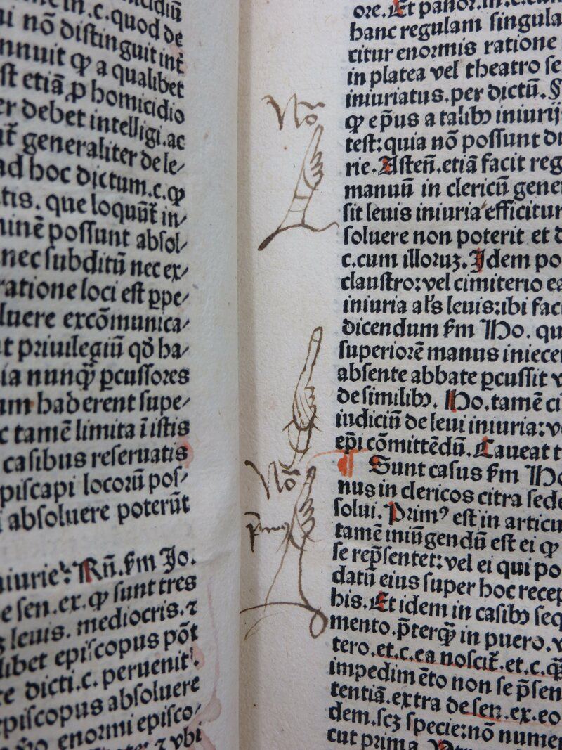 Multiple manicules.