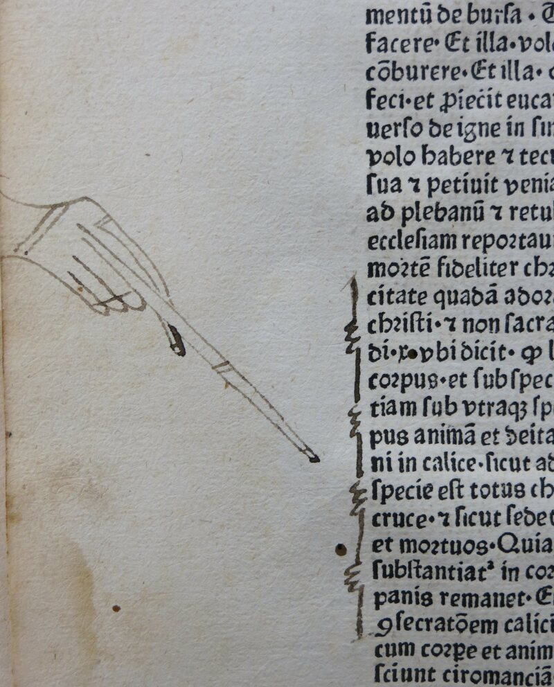 A large manicule with nails.