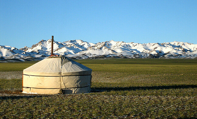 Traditional Mongolian <em>gers</em> are made of a felt cover stretched over an expanding circular wooden frame.