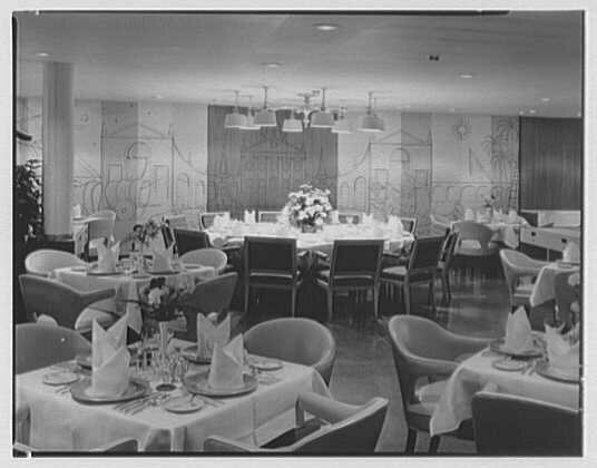 Folded napkins on display in a dining room, 1958.