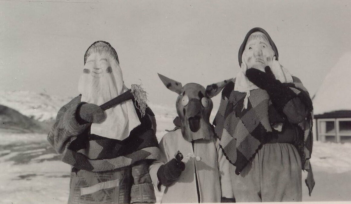 Unknown mummers in Harrington Harbour, circa 1950s.