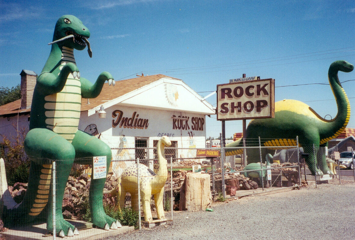 The Rainbow Rock Shop, complete with roadside dinosaurs, in Holbrook Arizona.