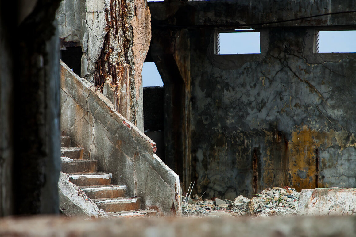 Rusting columns, walls, and stairs provide an art canvas for time to draw on.
