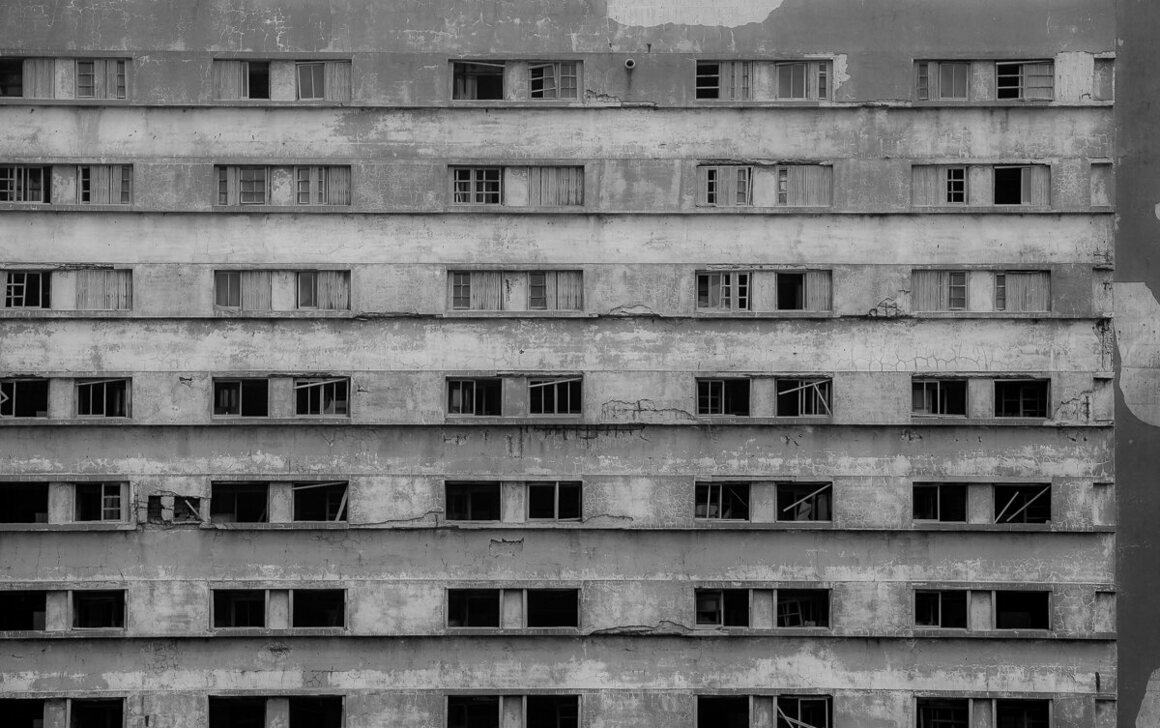 A pattern of windows at varying states of decay.