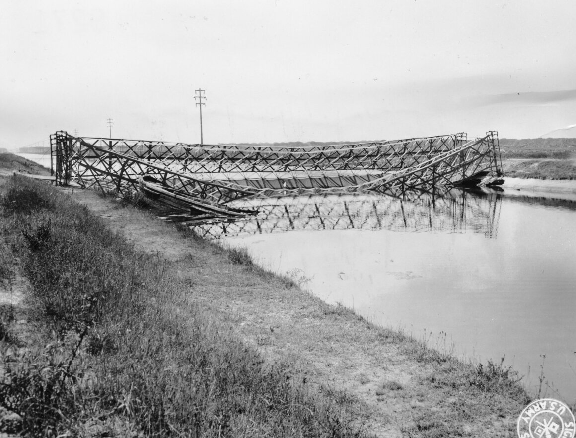 A dummy bridge built out of canvas and burlap. It was partially destroyed by Germans who saw it above the city of Pisa.