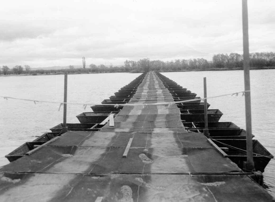 A dummy pontoon bridge made out of wood frames covered with cloth. It took the 84th Engineers 12 hours to build the bridge across the Rhine River at Petersau, Germany. It was meant to fool the Germans into thinking there were more bridges across the river than there actually were.