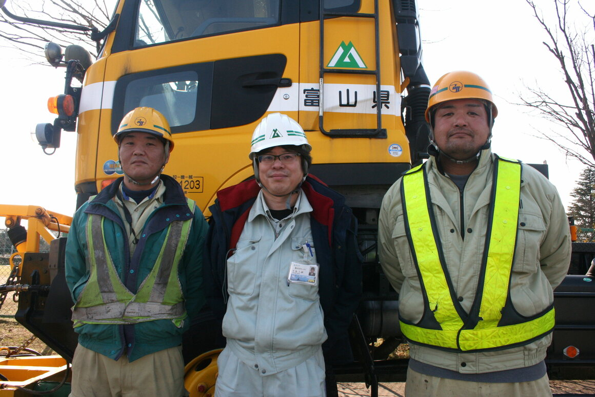 From left to right: Takahashi Iwamatsu, a Toyama snowplow driver; Yatsushi Ushijima, a road maintenance manager for Toyama Prefecture; and Takuma Igarashi, who is a snowplow driver in Toyama. He has been operating snow plows for more than 20 years.