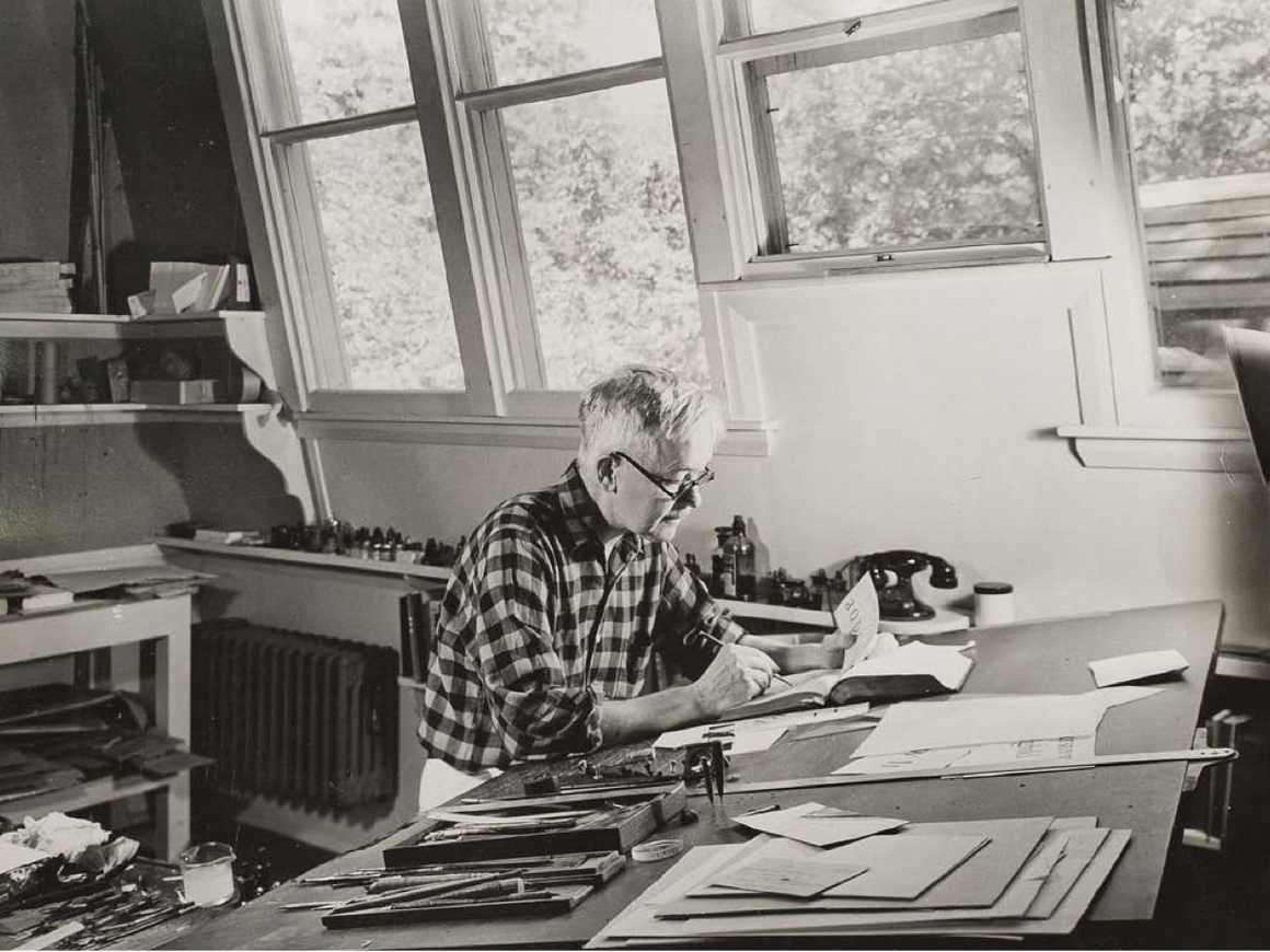 Dwiggins at his desk in 1941, working on type designs.