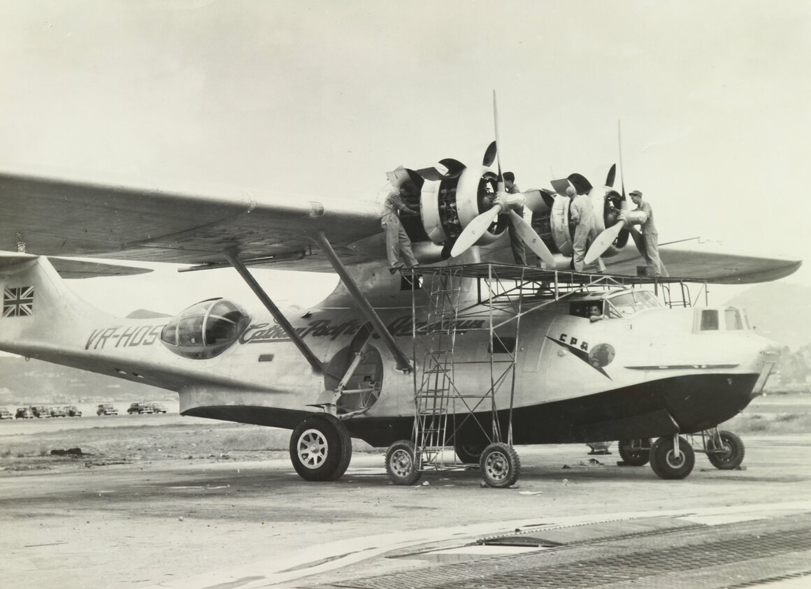 Cathay Pacific Airways Vickers OA-10 Catalina undergoing maintenance at Kai Tak Airport, circa 1949.