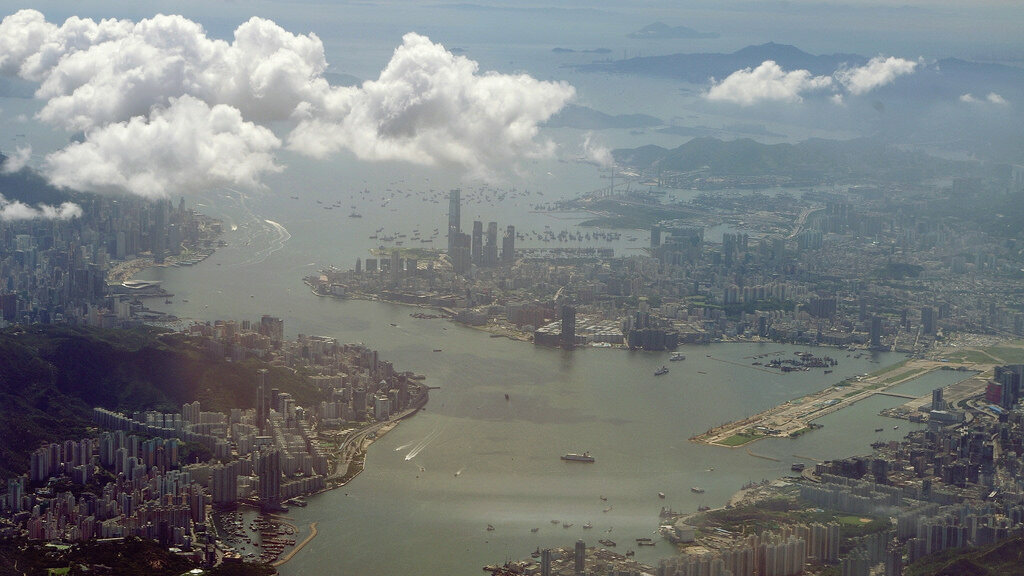 A view of Hong Kong in 2010, with the former Kai Tak airport site visible on the right.