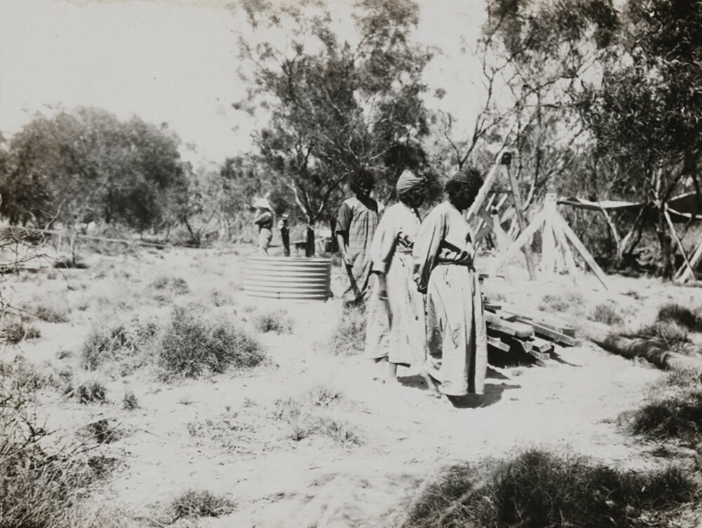 Women from the local indigenous community observe the camp.