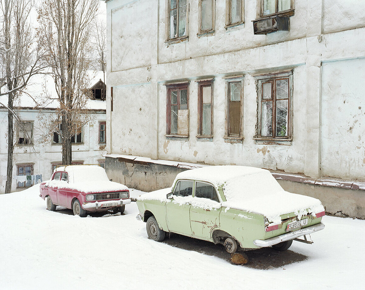 Two abandoned Soviet/Russian Moskovitch automobiles in Min Kush.