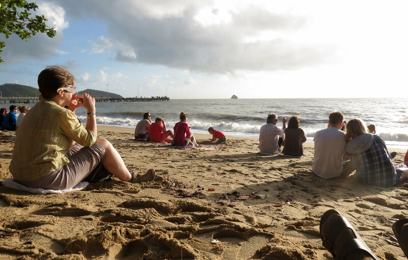 People gather on a beach in Australia to watch the 2012 eclipse.