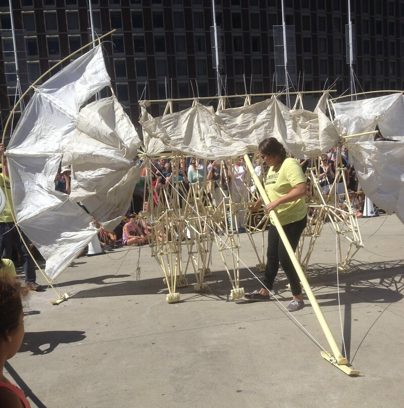 A Peabody Essex Museum volunteer coaxes a Strandbeest forward. (Photo: Atlas Obscura)