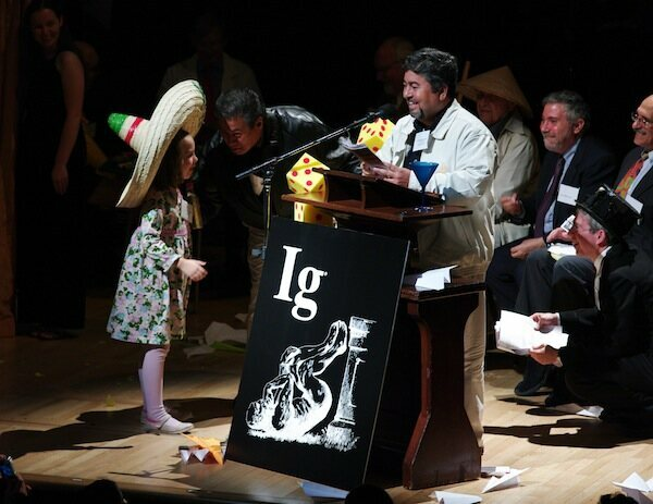 Chemistry Ig Nobel winner Javier Morales gets interrupted by Miss Sweetie Poo in 2009. Morales and his cohort discovered a way to turn tequila into diamonds. (Photo: )