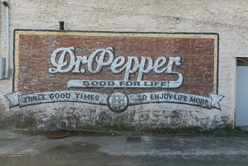 Old Dr Pepper mural on a building in the town of Hico in Hamilton County, Texas