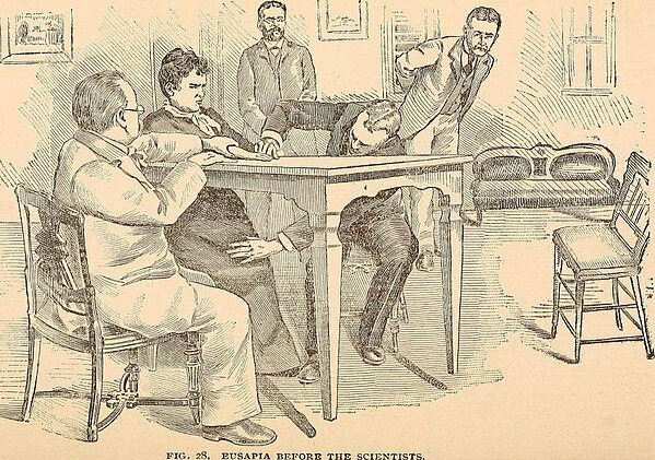 "An illustration from the 1897 book ""Hours with the ghosts, or, Nineteenth century witchcraft: illustrated investigations into the phenomena of spiritualism and theosophy"", showing scientists investigating the claims of a spirit medium"