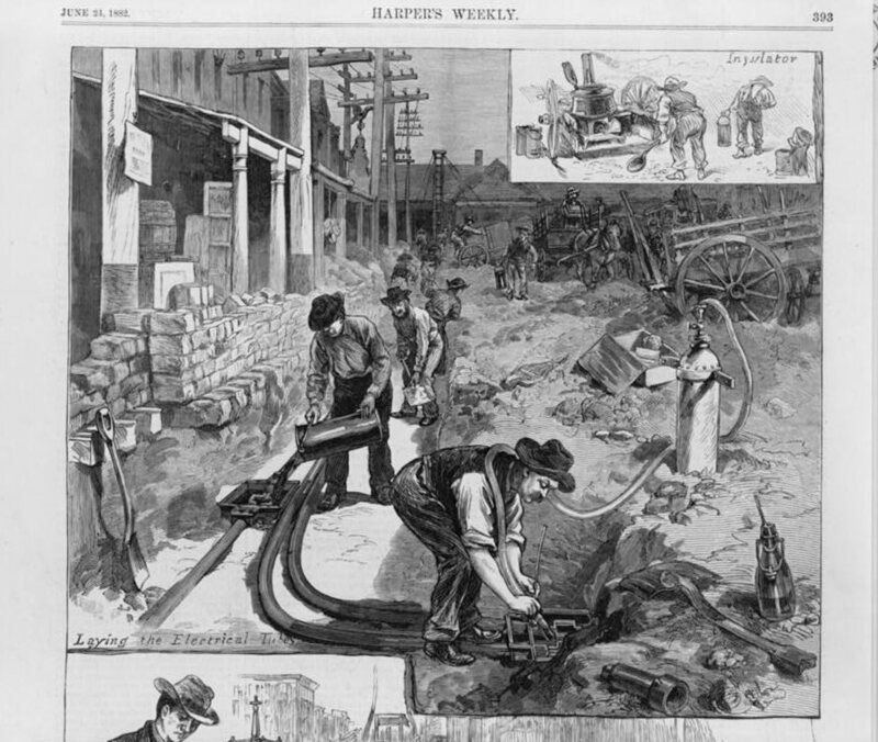 An illustration from June 21, 1882, of laying the tubes for electric wires in the streets of New York City, in order to wire houses