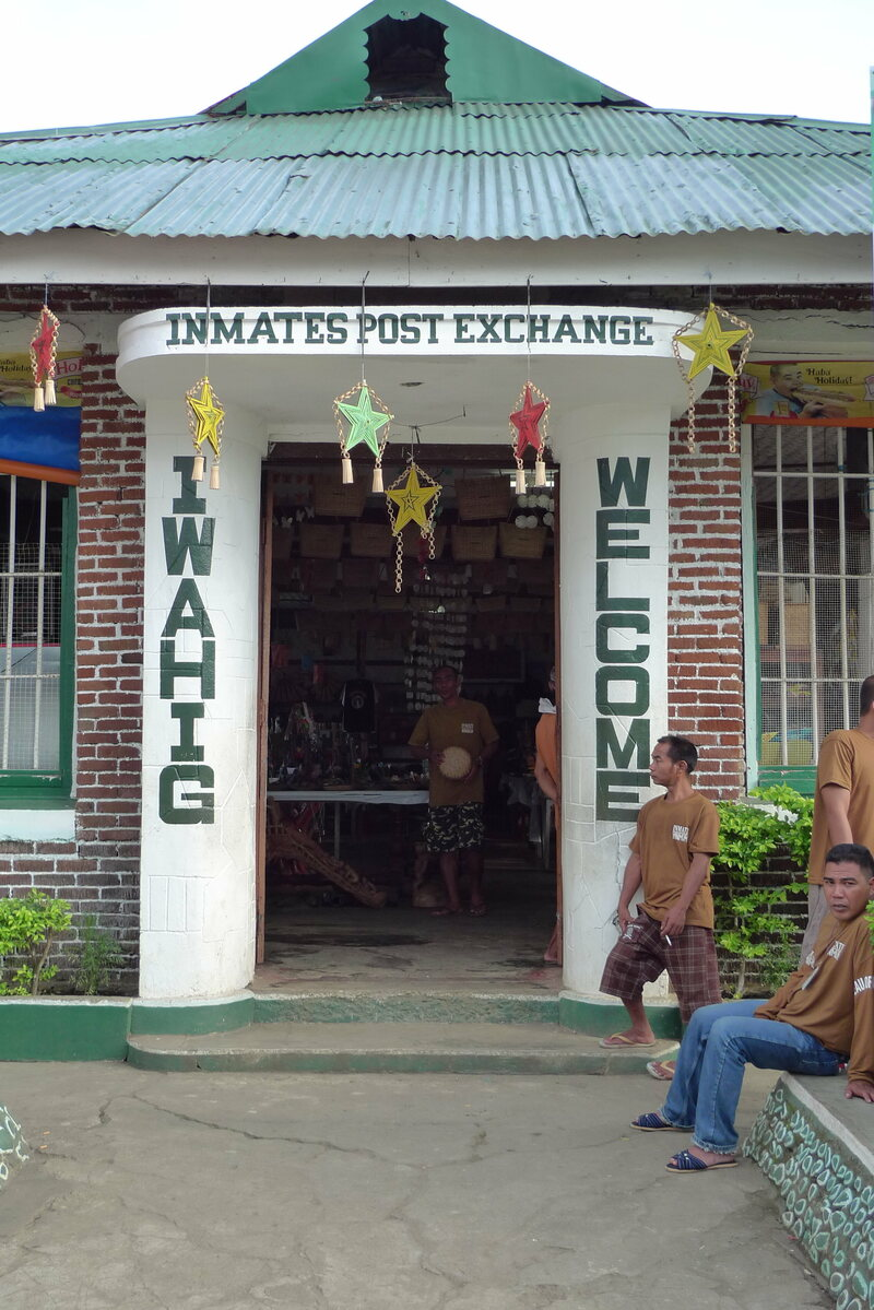 Entrance to the Iwahig Post Exchange. Minimum security inmates seated to the right.