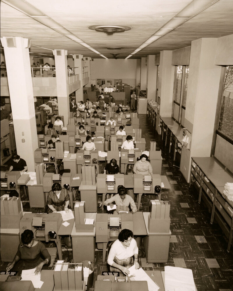 The data processing rooms were crammed with desks and largely staffed with female employees who processed documents that prompted and recorded the operations of the subway system. 1957.