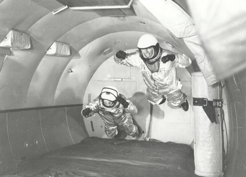 "The ""vomit comet"": (1959) Astronauts in simulated weightless flight in C-131 aircraft flying ""zero-g"" trajectory at Wright Air Development Center."