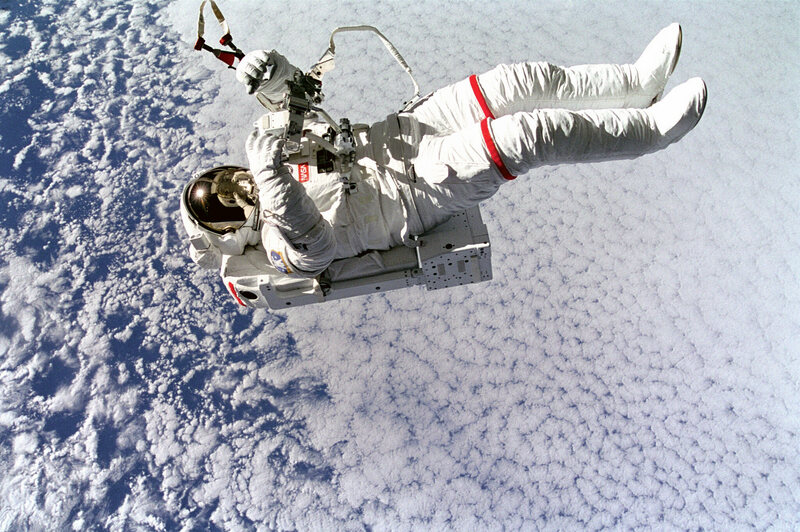 (September 16, 1994) Backdropped against clouds 130 nautical miles below, astronaut Mark C. Lee floats freely without tethers as he tests the new Simplified Aid for EVA Rescue (SAFER) system.