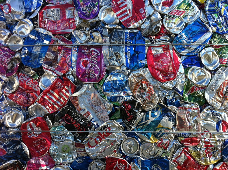 Detail from a bale of aluminum cans.