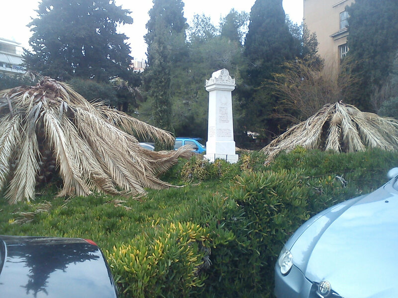 Dead palms in front of an Athenian hospital.