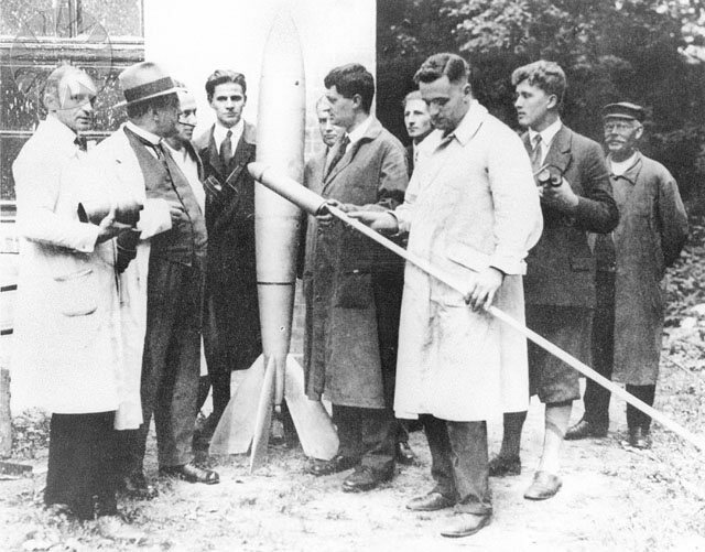 Members of the Society for Space Travel in 1930. Oberth is directly to the left of the rocket.
