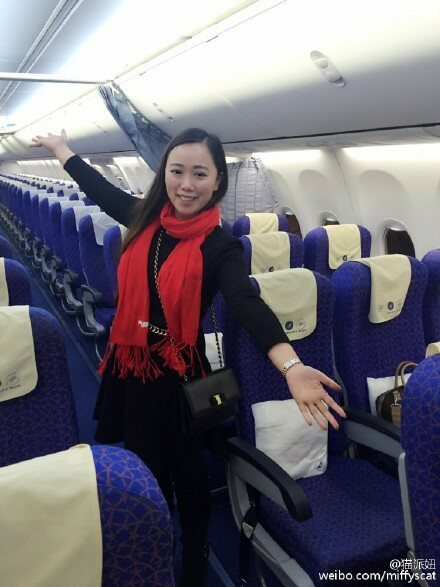 Zhang alone on the plane.