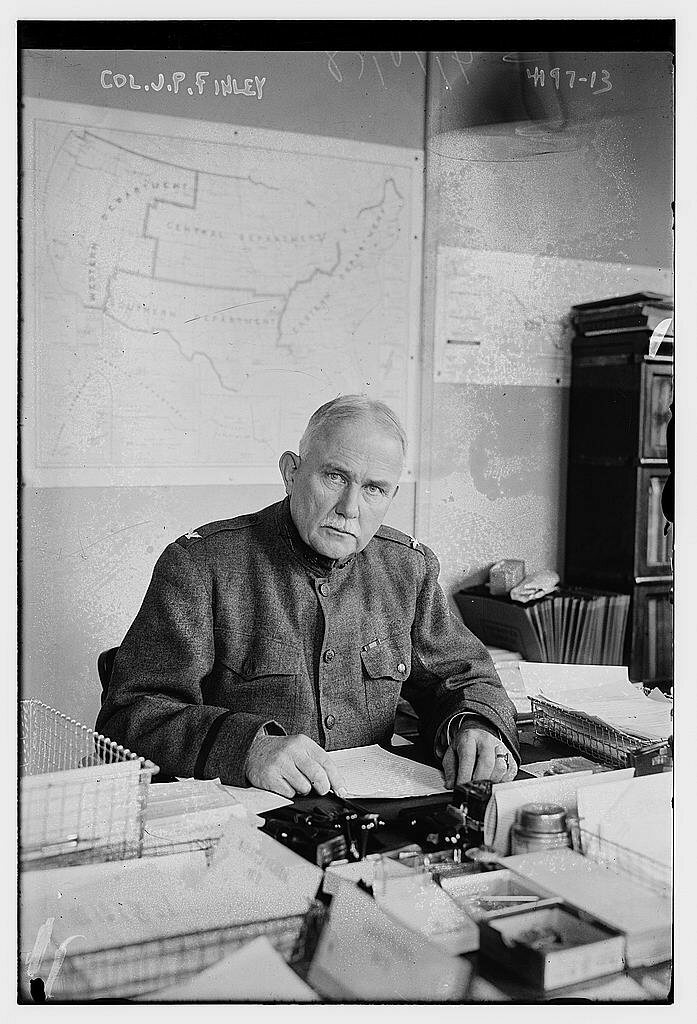 Colonel John Park Finley at his desk in 1917.