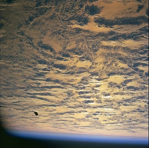 The loose space blanket floats above the earth.