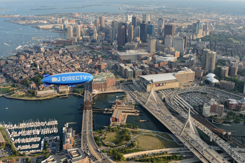 The DirectTV Blimp beats the traffic over Boston.