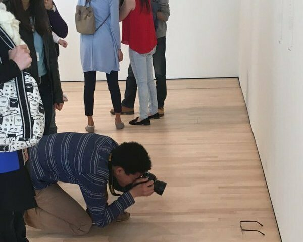 A MOMA visitor enjoys the new exhibit.