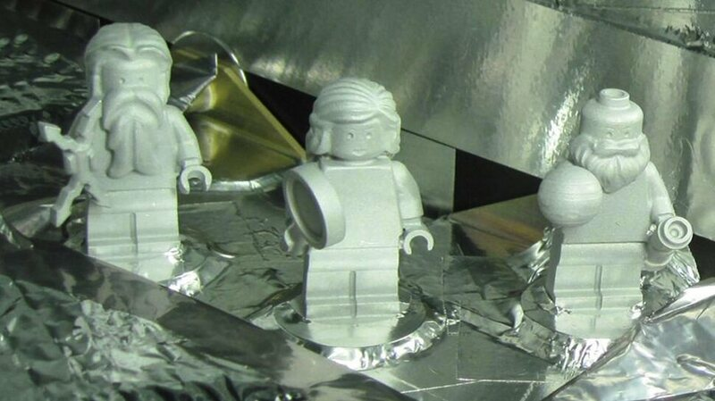 The three minifigs, in position on the spacecraft.
