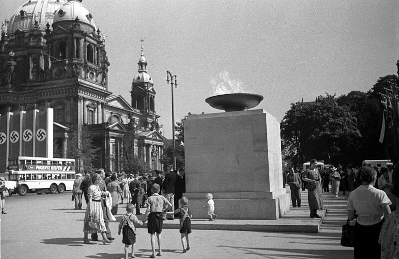 Children admire the Olympic Flame in Berlin in 1936.