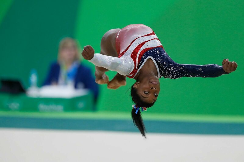 Simone Biles, mid-move, during the August 9th team competition.
