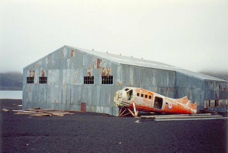 Abandoned hangar and fuselage