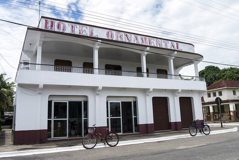 'Hotel Ornamental', one of only a few lodgings in town, is owned by a retired aquarium fish trader