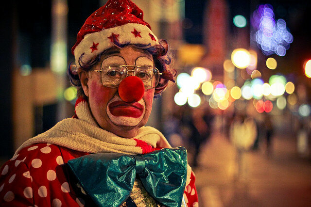 "Photographer Shawn Tron says this clown is frowning because ""the bus driver wouldn't stop for him."""