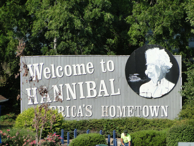 The welcome sign for Hannibal, Missouri, showing Mark Twain.