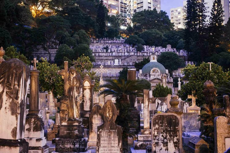 Many graves in St. Michael's crowd together, evidence of the city's decreasing space for burials. Hong Kong's overcrowded cemeteries darkly mirror its squeezed real estate market.