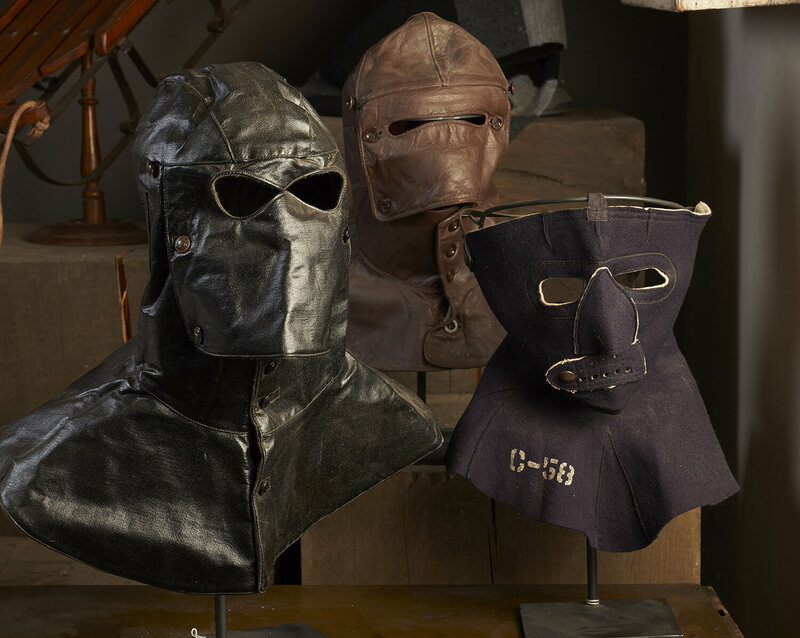 Masks for extreme cold weather. From left, a WWII submarine loader's hood, a Russian motorcycle mask and a WWII US Air Force flight mask.