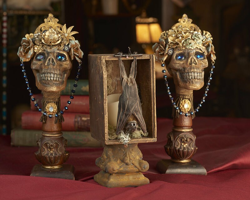 Bookends created from rosary beads and a desiccated bat.